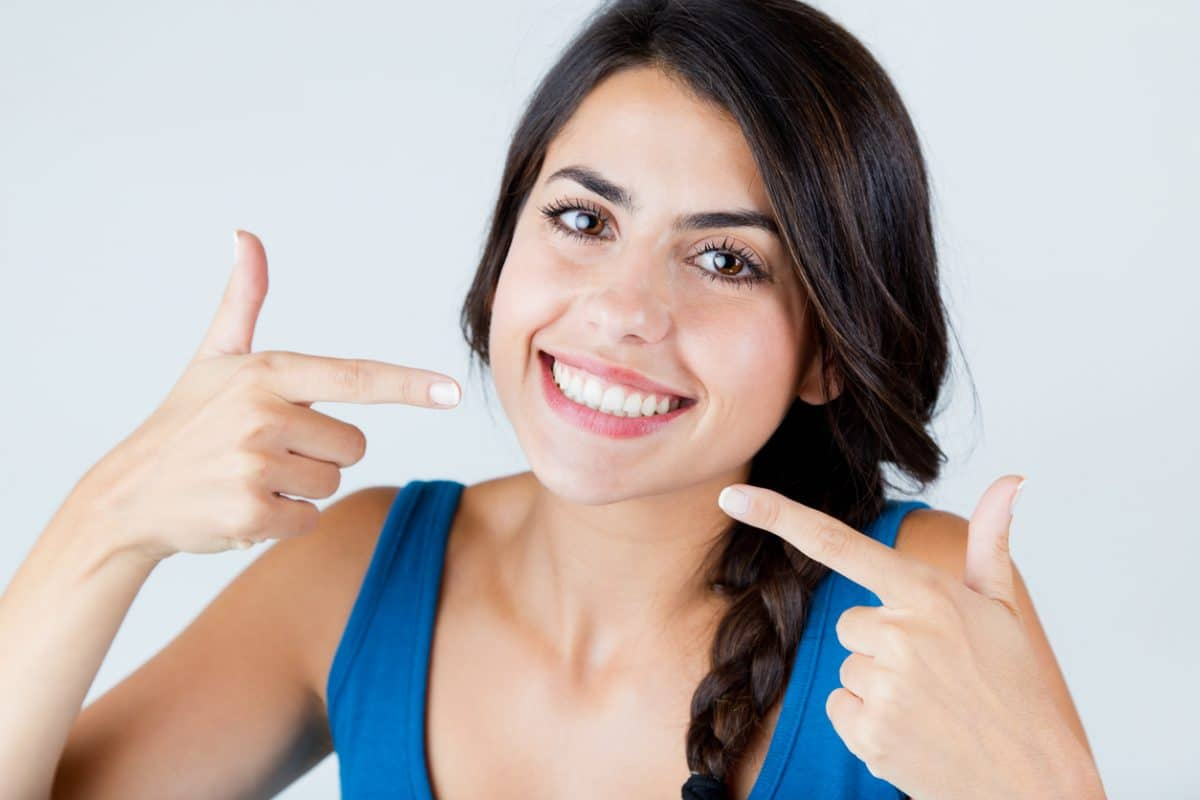 Confident Girl Pointing At Her Smile